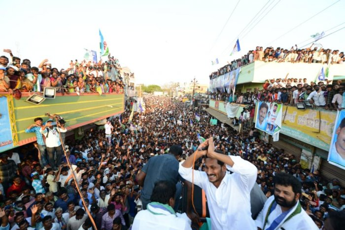 Y S Jaganmohan Reddy addressing people at a public meeting during an election road show in coastal Andhra Pradesh.