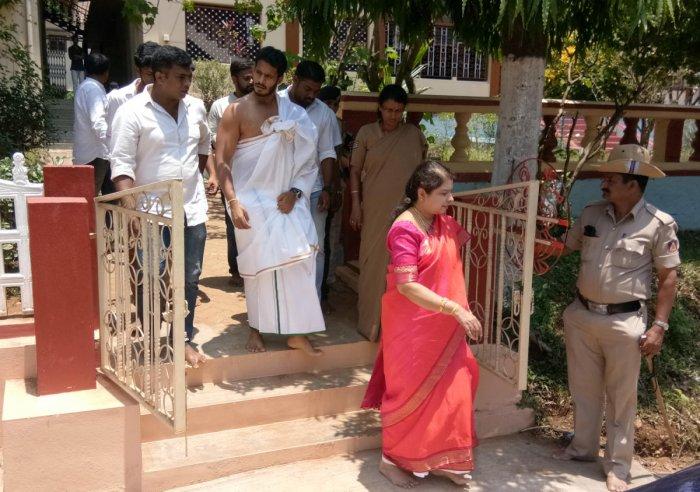 Chief minister's wife-MLA Anitha Kumaraswamy and son Nikhil come out of Gurubhavana after seeking the blessings of Sringeri Sharada Mutt pontiff on Wednesday.