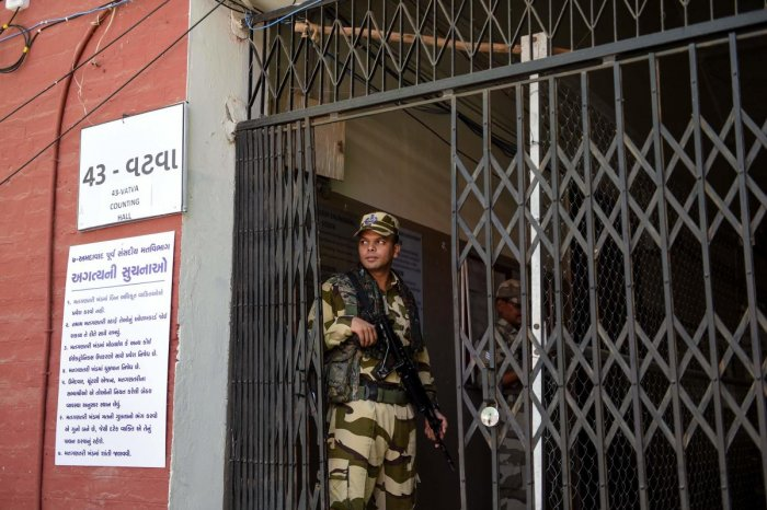 An Indian paramilitary soldier from the Central Industrial Security Force (CISF) stands guard at a counting centre. (Photo AFP)