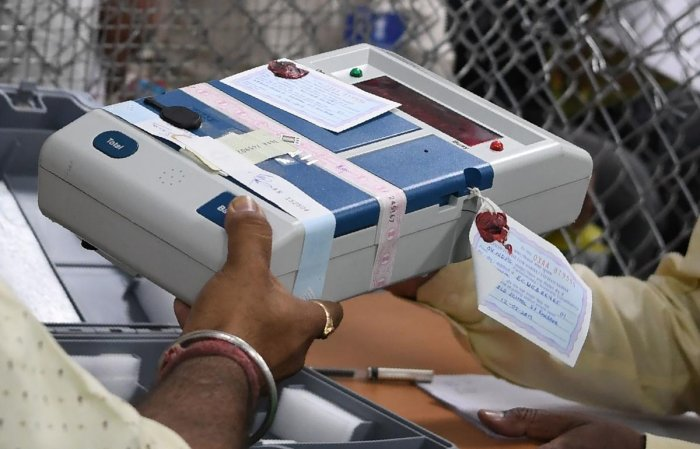 Indian election official holds an Electronic Voting Machine (EVM) at a polling counting centre. (Photo AFP)