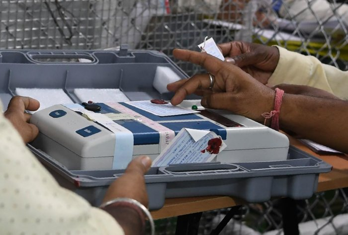 Indian election official checks an Electronic Voting Machine (EVM) at a polling counting centre in New Delhi (Photo by AFP)