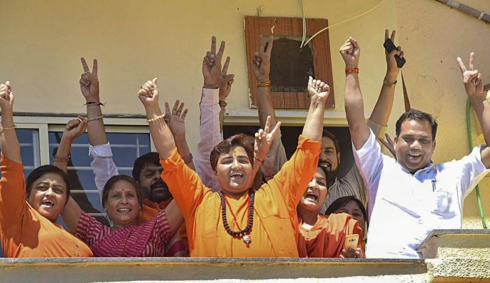 Pragya Singh Thakur along with the supporters celebrates her lead in the Lok Sabha elections 2019 as counting of votes is in progress, in Bhopal. PTI Photo