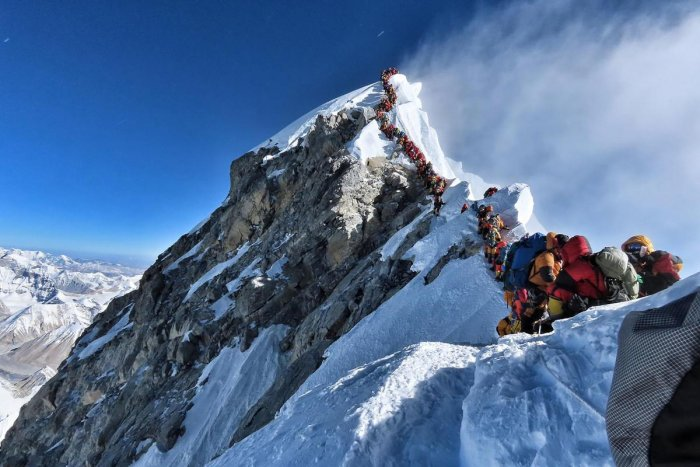 This handout photo taken on May 22, 2019 and released by climber Nirmal Purja's Project Possible expedition shows heavy traffic of mountain climbers lining up to stand at the summit of Mount Everest. AFP PHOTO