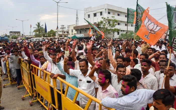 Supporters cheer for their leader Umesh Jadhav of BJP, who emerged victorious from Gulbarga Lok Sabha constituency, in Kalaburagi on Thursday. Prashanth H G