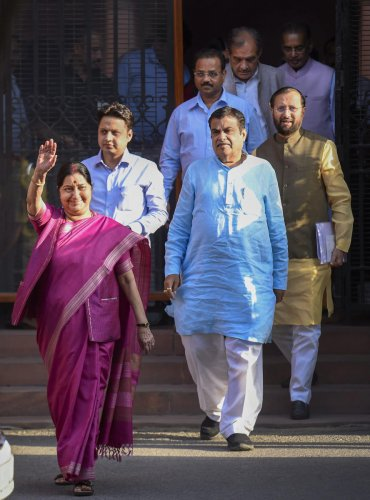 New Delhi: Union Ministers Sushma Swaraj, Nitin Gadkari and Prakash Javedkar leave after the conclusion of the Cabinet meeting, at South Block, in New Delhi, Friday, May 24, 2019. (PTI Photo/Atul Yadav)