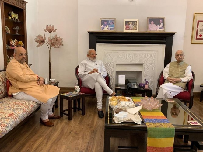 Prime Minister Narendra Modi and BJP chief Amit Shah on Friday called on party veterans LK Advani and Murli Manohar Joshi. ANI Photo.