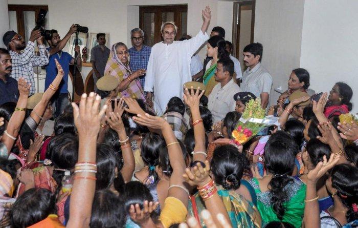 Women activists greet Biju Janata Dal (BJD) chief Naveen Patnaik after party's victory in Odisha assembly elections, in Bhubaneswar, Saturday, May 25, 2019. (PTI Photo)