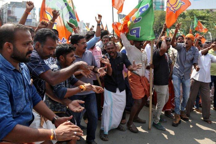 Supporters of India's ruling Bharatiya Janata Party (BJP) shout slogans in Kerala (PTI Photo)