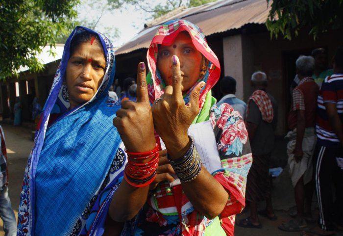 Ganjam: Voters show their finger marked with indelible ink after casting vote for the second phase of the general elections, at a polling station , Panchabhuti in Ganjam district. (PTI Photo)