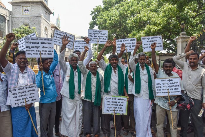 Farmers from Kodiyala Karenahalli, Bidadi Hobli stage a protest against transfer of lands as per the controversial TDR norms, for land filling and garbage segregation, in front of BBMP Office in Bengaluru on May 21, 2019. DH Photo/S K Dinesh