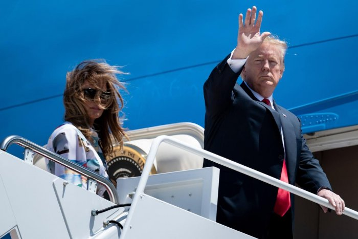 US President Donald Trump and First Lady Melania Trump board Air Force One at Joint Base Andrews in Maryland. The president is traveling to Japan for a three-day official visit. (Photo by AFP)