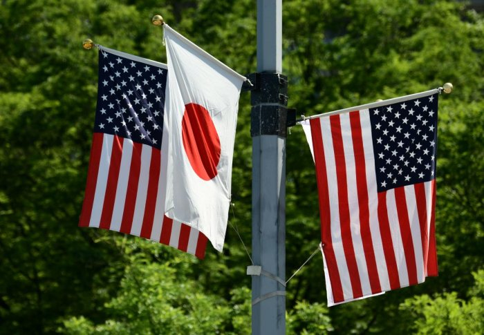 National flags of Japan and the US are displayed on a street in Tokyo on May 25, 2019. - US President Donald Trump will arrive in Japan on May 25 for a four-day trip likely to be dominated by warm words and friendly images, but light on substantive progre