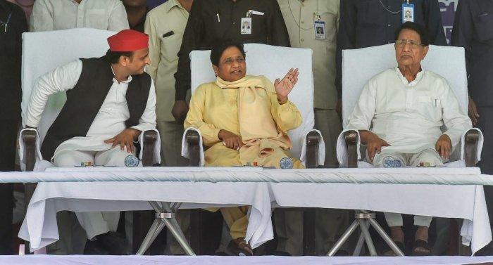 Bahujan Samajwadi Party chief Mayawati with Samajwadi Party chief Akhilesh Yadav, Rashtriya Lok Dal chief Ajit Singh at an SP-BSP alliance election rally for Lok Sabha polls, in Varanasi on May 16, 2019. (PTI Photo)