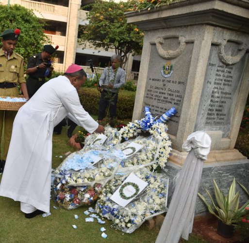 The Archbishop of Bangalore Peter Machado pays tribute at the war memorial at Old boy martyrs at St Joseph's Boys High School in Bengaluru on May 25, 2019. (DH PHOTO/JANARDHAN B K)