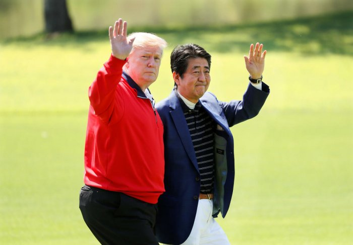 U.S. President Donald Trump and Japanese Prime Minister Shinzo Abe wave on the way to the course to play golf at Mobara Country Club in Mobara, Chiba Prefecture, east of Tokyo, Japan May 26, 2019. Kimimasa Mayama/Pool via Reuters