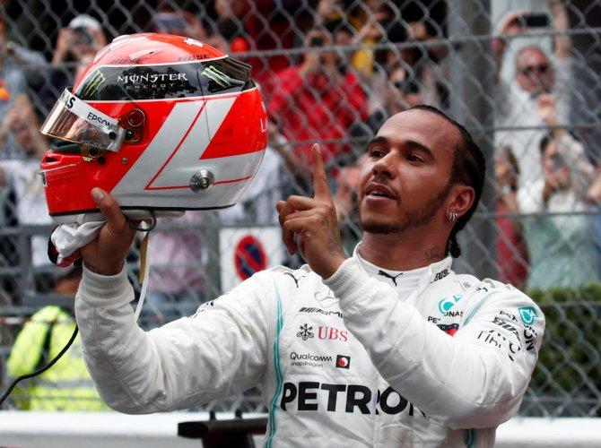 Mercedes' Lewis Hamilton celebrates after winning the Monaco Grand Prix on Sunday REUTERS