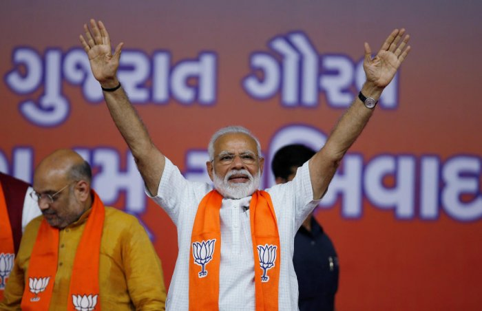 India's Prime Minister Narendra Modi gestures as he arrives to address his supporters at a public meeting in Ahmedabad, India, May 26, 2019. (REUTERS)
