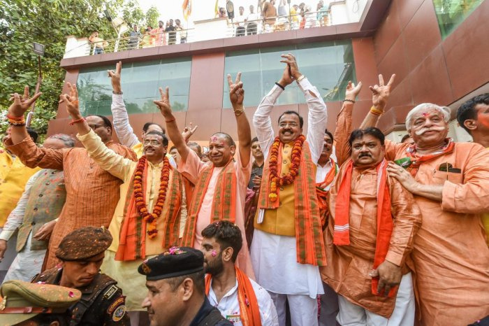 Lucknow: Uttar Pradesh Chief Minister Yogi Adityanath with his Deputies Keshav Prasad Maurya and Dinesh Sharma and others celebrate the party's performance in Lok Sabha elections, at BJP office in Lucknow, Thursday, May 23, 2019. (PTI Photo/Nand Kumar)
