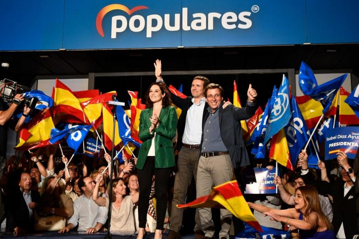 Leader of Spanish People's Party (PP), conservative Pablo Casado (C), celebrates the election results with PP candidate to Madrid's regional government Isabel Diaz Ayuso (L) and PP candidate to Madrid's mayoralty Jose Luis Martinez Almeida during an elect