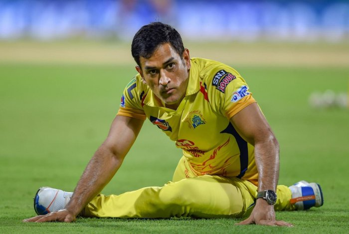 CSK skipper MS Dhoni stretches at the commence of the Indian Premier League 2019 (IPL T20) cricket match between Chennai Super Kings (CSK) and Sunrisers Hyderabad (SH), at MAC Stadium in Chennai, Tuesday, April 23, 2019. (PTI Photo)