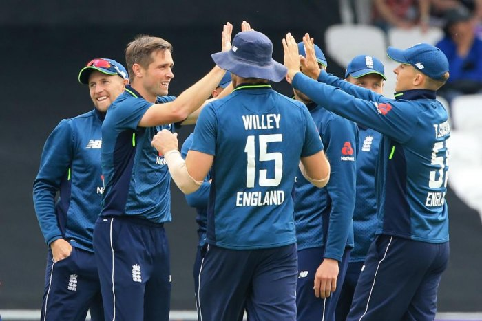 WRECKER IN CHIEF England's Chris Woakes (second from left) celebrates with team-mates after taking the wicket of Pakistan's Mohammad Hafeez. AFP