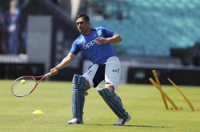 GOOD HANDS: MS Dhoni indulges in a game of tennis during India's practice session at the Oval. AP/ PTI