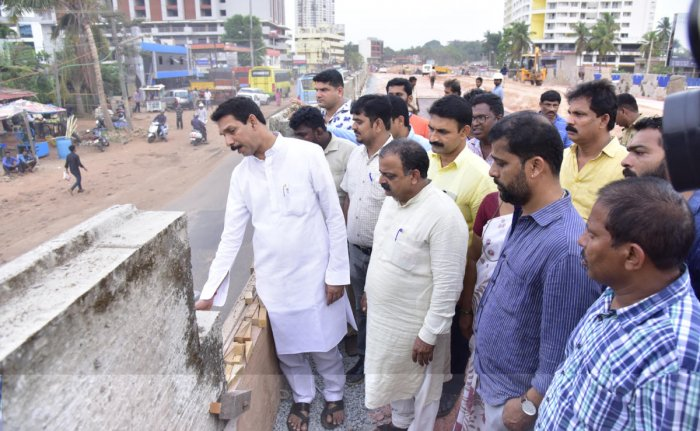 Dakshina Kannada MP Nalin Kumar Kateel inspects the ongoing work at the site of the Pumpwell (Mahaveer) flyover in Mangaluru on Wednesday.