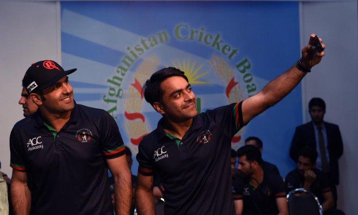 Afghan national team cricketers Rashid Khan (R) and Mohammed Nabi (Photo AFP)