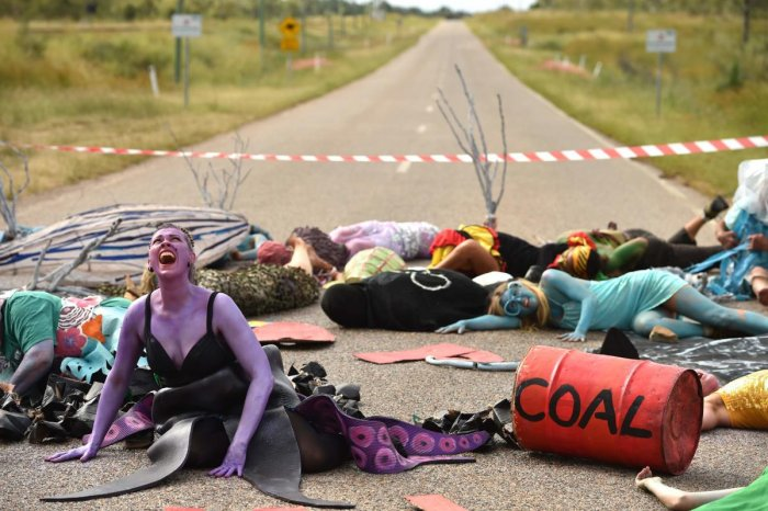 In this photo taken on May 1, 2019 shows environmental campaigners holding a protest against the development of the India-backed Adani coal mine at the entrance of Abbot Point port near the Queensland state town of Bowen, where the commodity will be shipp