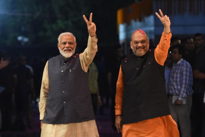 With Amit Shah taking oath as a Cabinet minister in the second term of Modi-led Union government, he is set to get an important portfolio and will have to resign from the party president post. AFP File photo