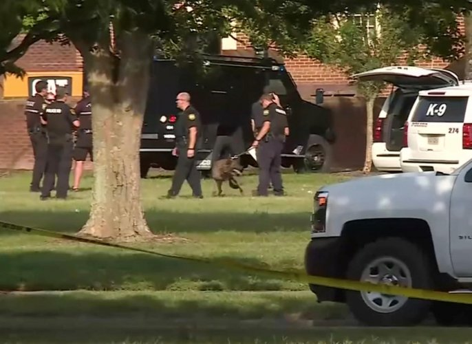 A police canine unit stands by in this still image taken from video following a shooting incident at the municipal center in Virginia Beach, Virginia (Photo Reuters)