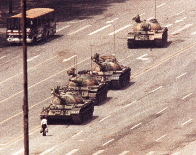 A man stands in front of a convoy of tanks in the Avenue of Eternal Peace in Beijing, China, June 5, 1989. (REUTERS/Arthur Tsang/File Photo)