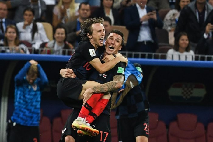 Croatia's Luka Modric and Mario Mandzukic celebrate their win at the end of the World Cup semi-final match against England at the Luzhniki Stadium in Moscow on Wednesday. AFP