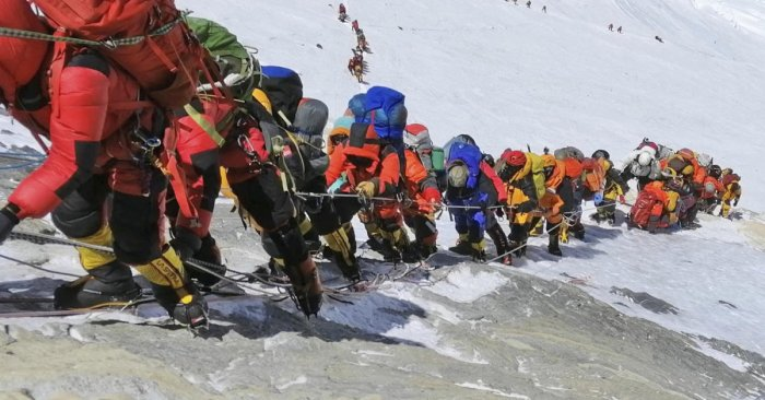 In this May 22, 2019 photo, a long queue of mountain climbers line a path on Mount Everest just below camp four, in Nepal. Seasoned mountaineers say the Nepal government's failure to limit the number of climbers on Mount Everest has resulted in dangerous