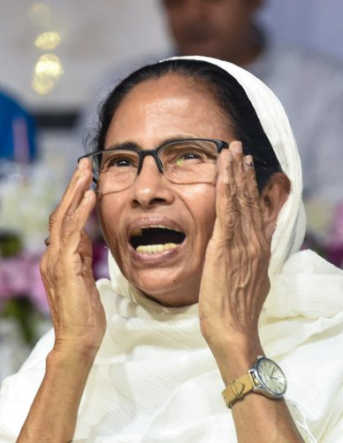 Banerjee, whose Trinamool Congress suffered reverses in the recent Lok Sabha elections, greeted people at Red Road here where a crowd of over 25,000 had gathered to offer 'namaz'. PTI File Photo