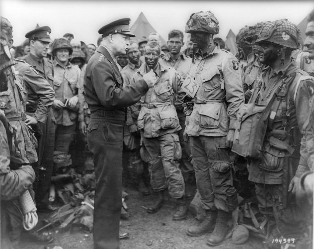 Allied forces Supreme Commander General Dwight D. Eisenhower speaks with U.S. Army paratroopers of Easy Company, 502nd Parachute Infantry Regiment (Strike) of the 101st Airborne Division, at Greenham Common Airfield in England June 5, 1944 in this handout
