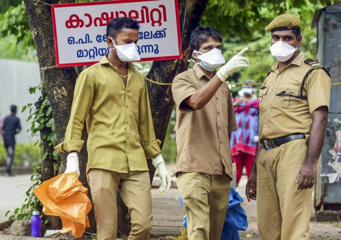 Security officials wear masks as a protective measure after reports of outbreak of Nipah virus, outside the Ernakulam Medical College in Kochi, Tuesday, June 4, 2019. (PTI Photo)