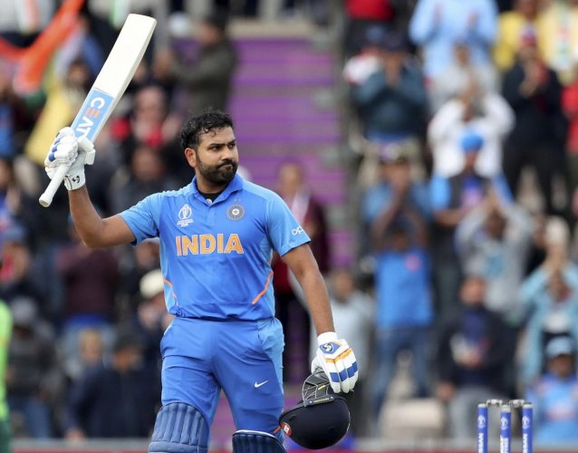 Rohit Sharma raises his bat to celebrate scoring a century during the Cricket World Cup match between South Africa and India at the Hampshire Bowl in Southampton, England, Wednesday, June 5, 2019. (AP/PTI)