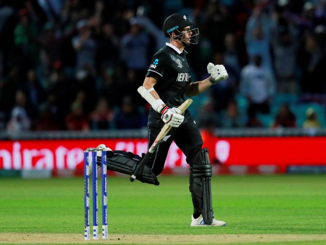 New Zealand's Mitchell Santner celebrates at the end of the match against Bangladesh. (Reuters Photo)