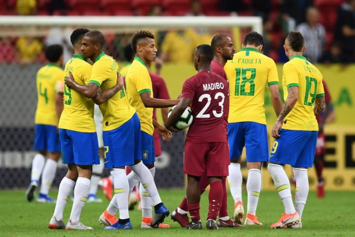 Brazil's players and Qatar's players greet each other at the end of a friendly football match at the Mane Garrincha stadium in Brasilia on June 5, 2019, ahead of Brazil 2019 Copa America. (AFP)