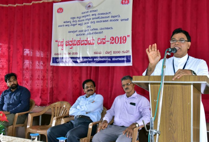 Milagres Educational Institutions Campus Director Fr Michael Santhumayor addressing the gathering after inaugurating the programme organised to mark World Schizophrenia Day at Milagres Pre-University College auditorium on Thursday.