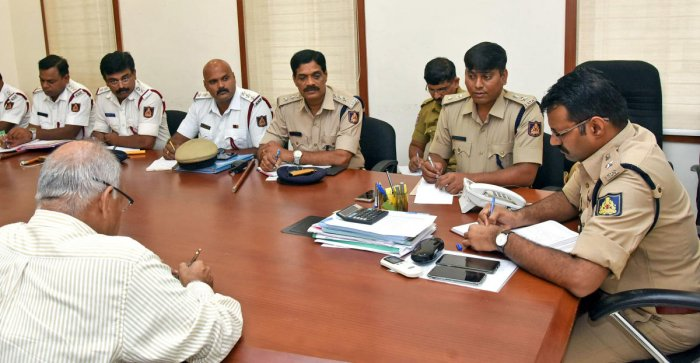 DCP Hanumantharaya speaks at a phone-in programme in Mangaluru on Friday. DH photo