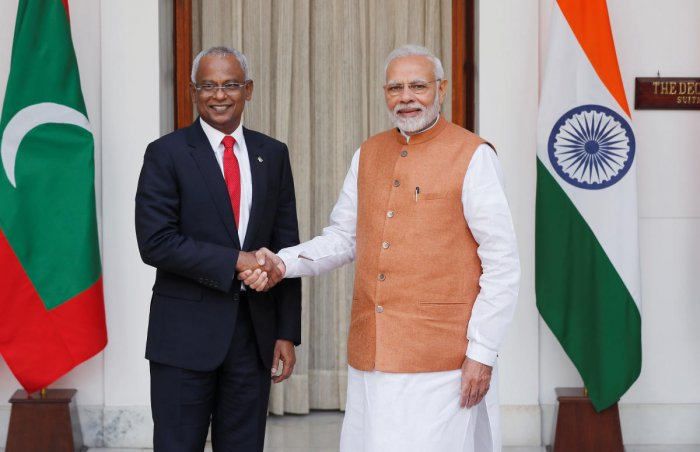 Maldives President Solih and India's PM Modi shake hands ahead of their meeting in New Delhi in this dated file photo. (December 17, 2018) Reuters.
