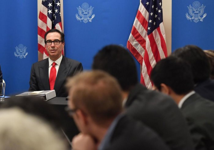 US Treasury Secretary Steven Mnuchin (L) speaks to the media during the G20 finance ministers and central bank governors meeting in Fukuoka. (AFP Photo)