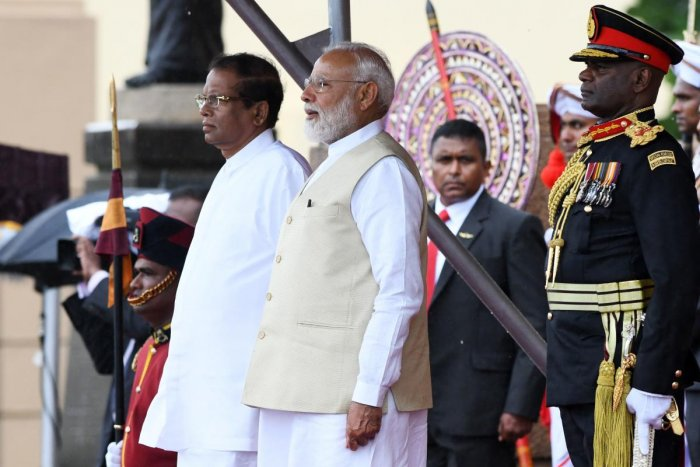 Indian Prime Minister Narendra Modi (C) and Sri Lankan President Maithripala Sirisena (L) attend a welcoming ceremony for Modi at the Presidential Secretariat, in Colombo. AFP photo