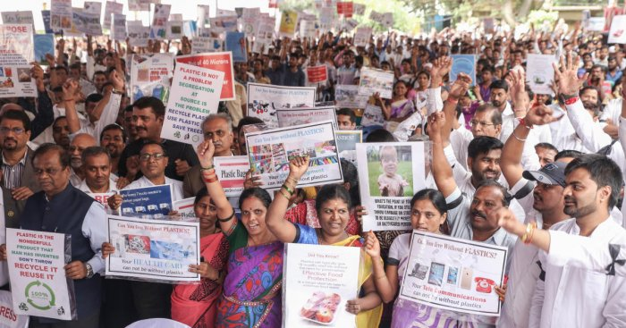 """The members of the Karnataka State Plastic Association staged a protest against the plastic ban stating that the government's move is """"unscientific"""" and """"unjustified"""", on Friday at the Freedom Park. DH photo"""