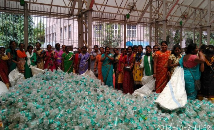 BBMP workers are seen calculating the amount of plastic waste collected during Plog Run at BBMP head office. DH file photo