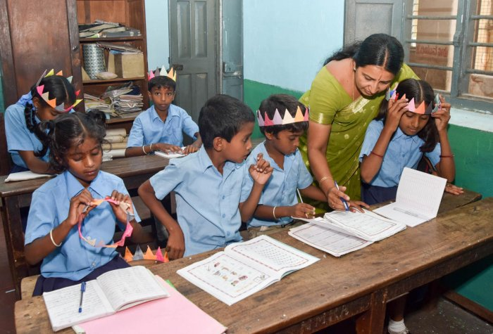 Students seen school on the first of new academic year start at Government School, Chamaraja Double Road in Mysuru. DH PHOTO / SAVITHA B R