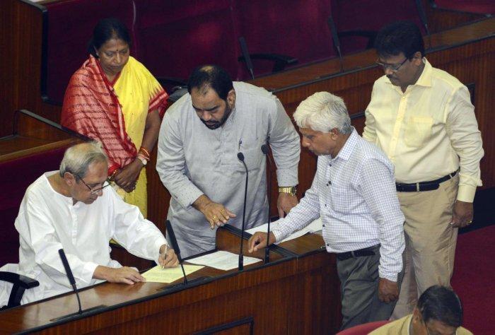 Bhubaneswar: Odisha Chief Minister Naveen Patnaik signs a register as he takes oath as an MLA at Odisha Legislative Assembly, in Bhubaneswar. (PTI File Photo)