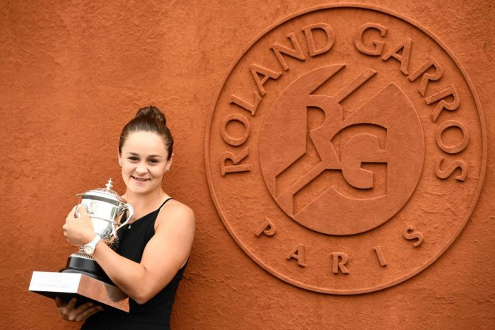 INSPIRING: Australia's Ashleigh Barty poses with the French Open trophy on Sunday. AFP